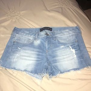 Express light colored jean shorts. Size 4.